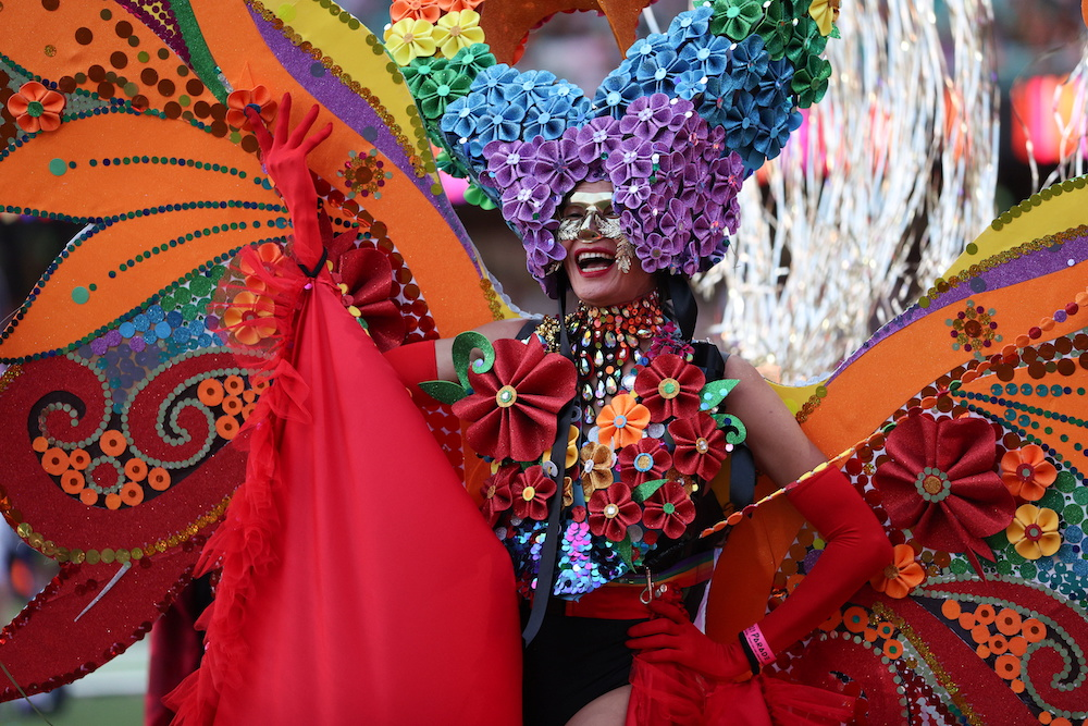 A participant celebrates the Sydney Gay and Lesbian Mardi Gras Parade under coronavirus disease safety guidelines at the Sydney Cricket Ground in Sydney, Australia, March 6, 2021. — AFP pic