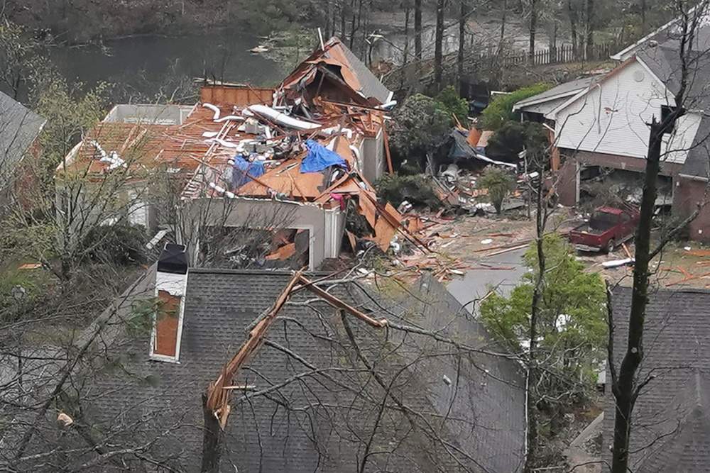 A house is left missing a roof after a tornado passed through the Eagle Point subdivision in Hoover, Alabama, US, March 25, 2021. — Reuters pic