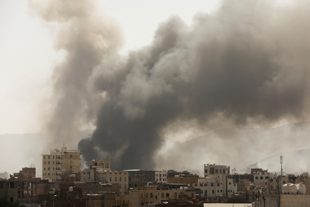 Smoke billows from the site of Saudi-led air strikes in Sanaa, Yemen March 7, 2021. — Reuters pic