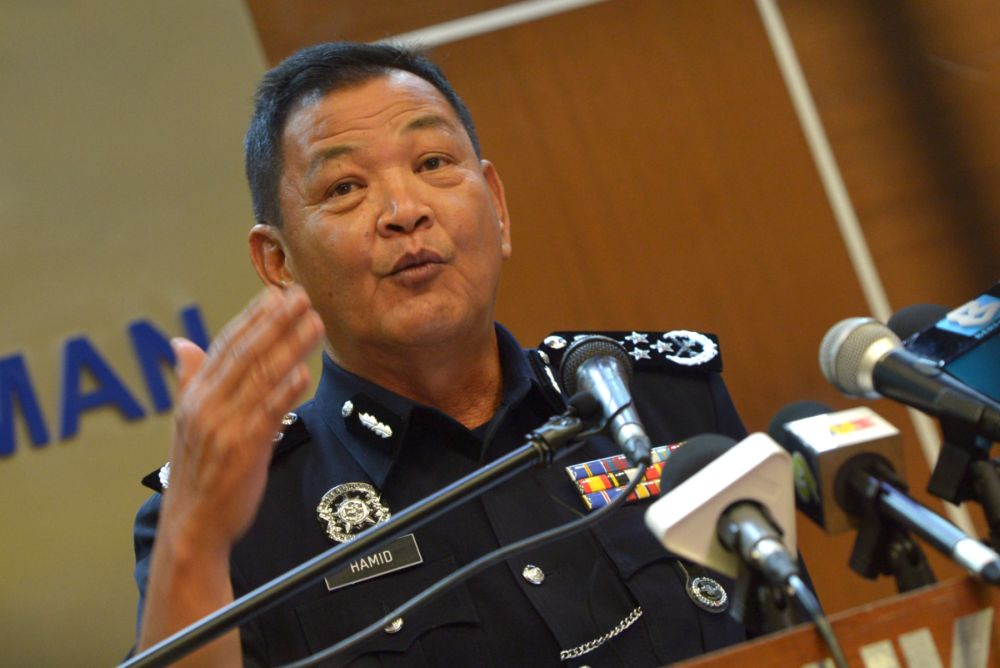Inspector-General of Police Tan Sri Abdul Hamid Bador speaks during a press conference at Bukit Aman March 11, 2021. — Picture by Miera Zulyana