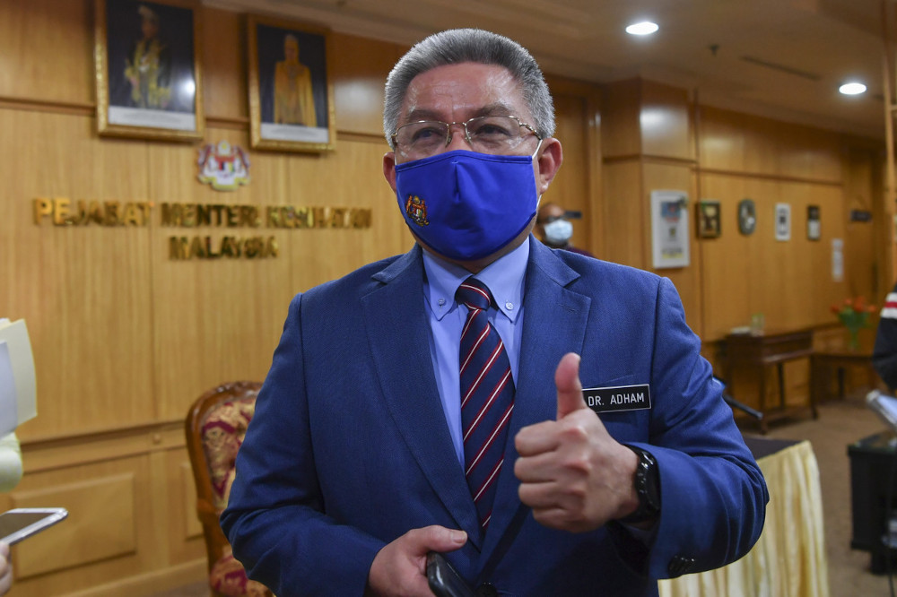 Health Minister Datuk Seri Dr Adham Baba during a press conference in the presence of Minister in the Prime Minister's Department (Parliament and Law) Datuk Seri Takiyuddin Hassan at the Health Ministry March 3, 2021. — Bernama pic