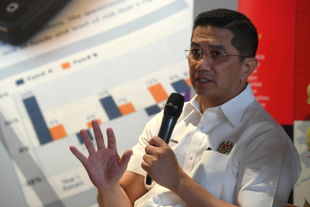 Datuk Seri Mohamed Azmin Ali speaks to the media after the launch of the Business Travellers Centre at the Kuala Lumpur International Airport in Sepang, March 23, 2021. — Bernama pic