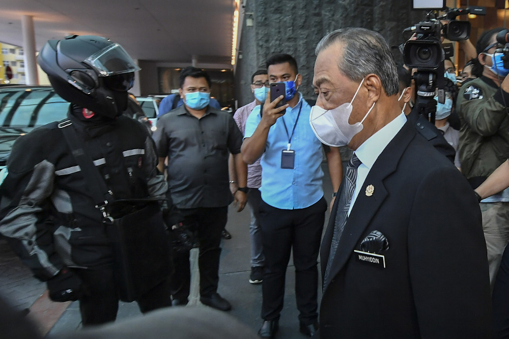 Tan Sri Muhyiddin Yassin leaves after chairing the Bersatu Supreme Council meeting at a hotel in Kuala Lumpur March 4, 2021. — Bernama pic
