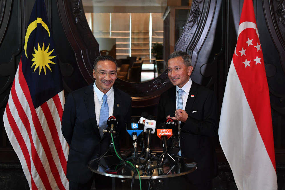 File picture shows Malaysian Foreign Minister Datuk Seri Hishammuddin Hussein with his Singapore counterpart Dr Vivian Balakrishnan holding a joint press conference after a bilateral meeting in Putrajaya, March 23, 2021. — Bernama pic