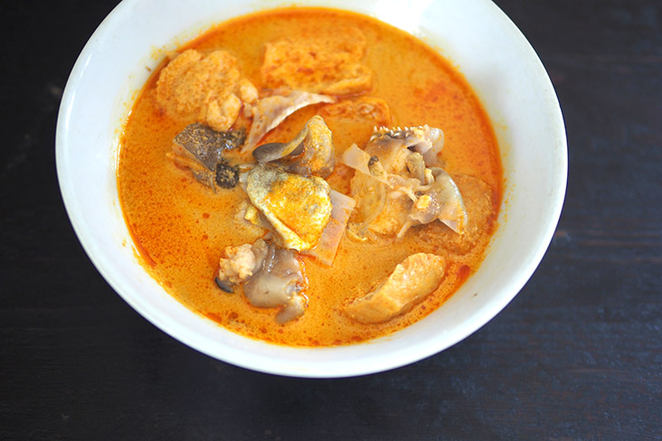 The highlight is the gelatinous skin on the 'sek pan' fish head paired with the curry broth