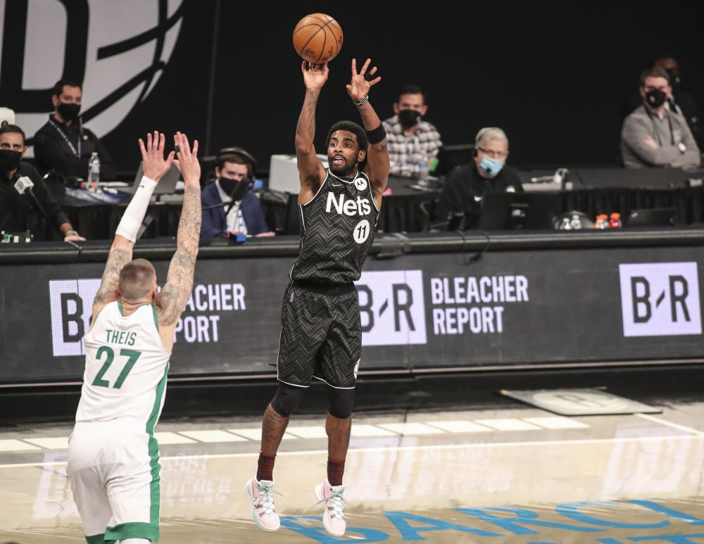 Brooklyn Nets guard Kyrie Irving (11) shoots a three point shot in the third quarter against the Boston Celtics at Barclays Centre, Brooklyn March 11, 2021.— Reuters  pic