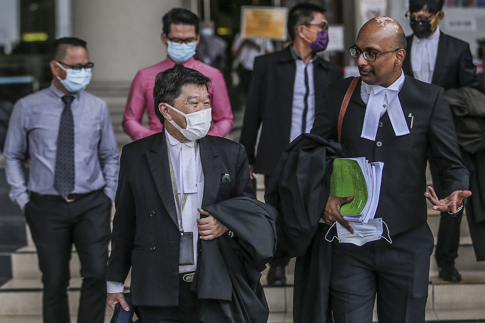 Jill Ireland Lawrence Bill's lawyers Annou Xavier (right) and Lim Heng Seng (left) are seen at the Kuala Lumpur High Court after the court's quashing of the government ban on the word 'Allah' in Christian publications, March 10, 2021. ― Picture by Hari Anggara