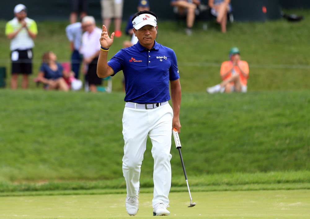 KJ Choi waves to the crowd on the 14th green during the second round of the 2019 Memorial golf tournament at Muirfield Village Golf Club May 31, 2019. — Reuters pic