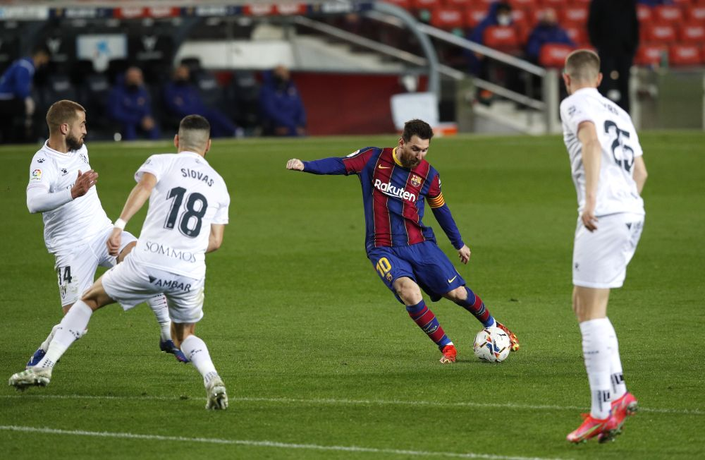 Barcelona's Lionel Messi scores their fourth goal against Huesca at Camp Nou, Barcelona March 15, 2021. — Reuters pic