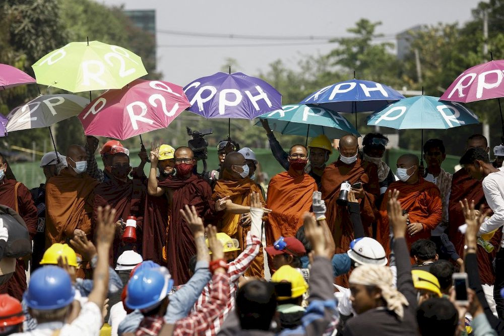 Monks take part in a demonstration against the military coup in Yangon on March 11, 2021. —AFP pic