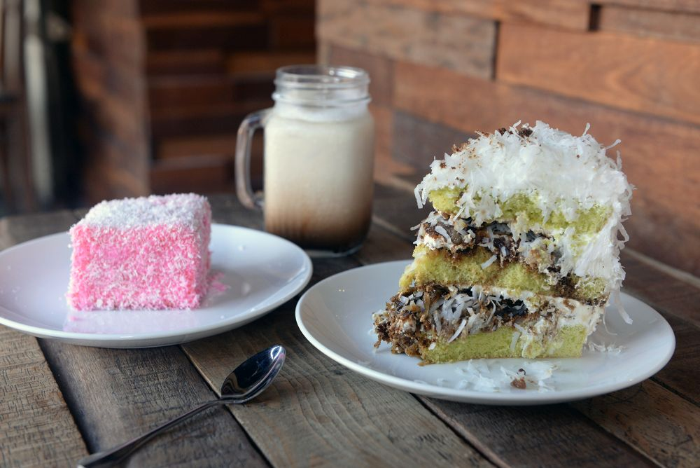 Treat yourself to a lamington (left) and a slice of the very popular Onde-onde cake.