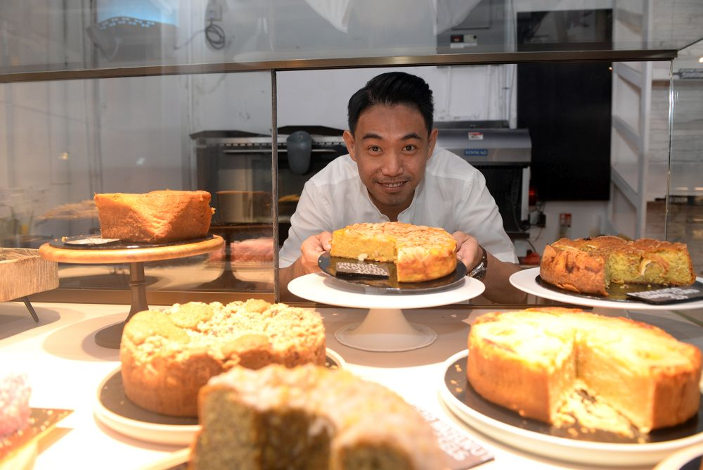 Mugshot's Jesse Tan with one of the many cakes on display. — Pictures by Steven Ooi KE