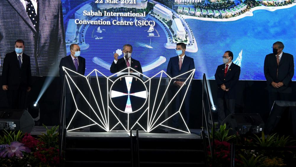 Prime Minister Tan Sri Muhyiddin Yassin (third from left) officiates the launch of the Lok Kawi Resort City development at the Sabah International Convention Centre March 22, 2021. — Bernama pic