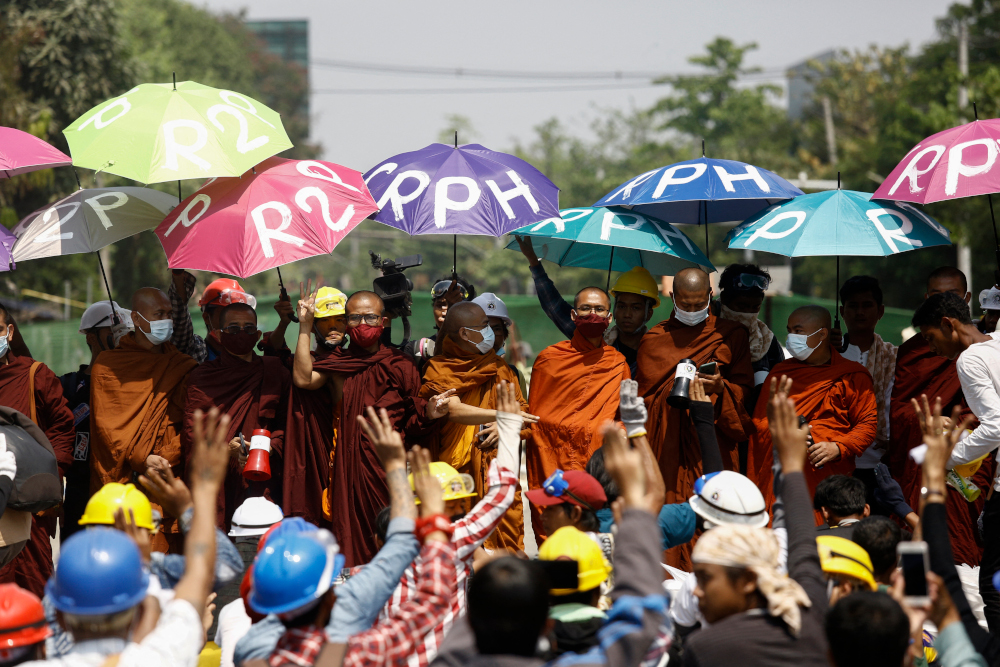Monks take part in a demonstration against the military coup in Yangon March 11, 2021. — AFP pic