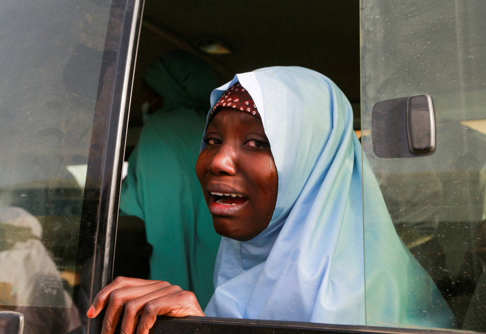 A rescued JSS Jangebe schoolgirl reacts after arriving in Jangebe, Zamfara, Nigeria March 3, 2021. — Reuters pic