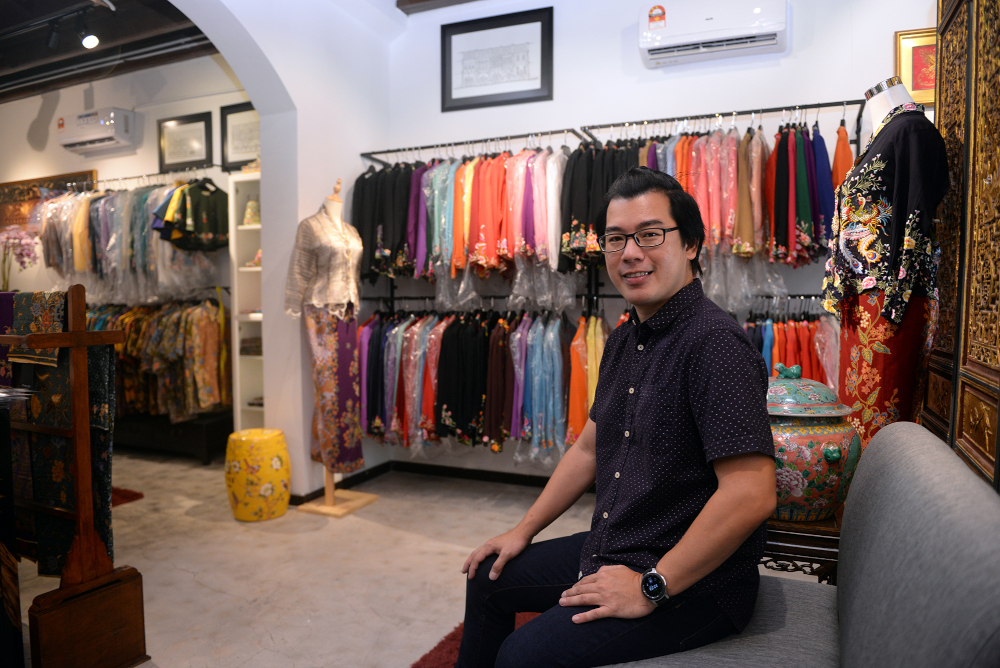 Kenny is a fifth generation Baba who designs and hand sews Nyonya kebaya and beaded shoes under his Kenny Loh Couture line. — Picture by Steven Ooi KE