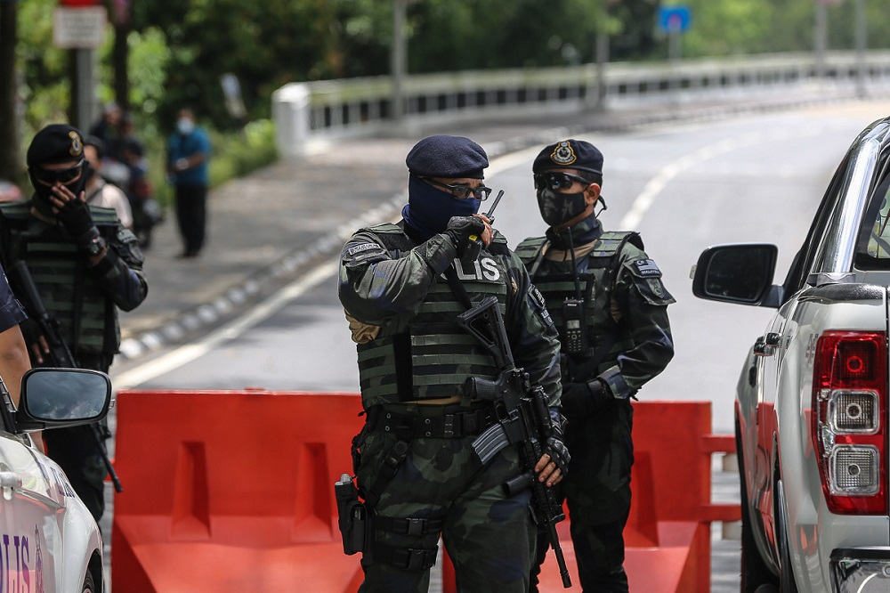 Police personnel in full tactical gear are seen standing guard at the road heading to Parliament in Kuala Lumpur March 27, 2021. ― Pictures by Yusof Mat Isa