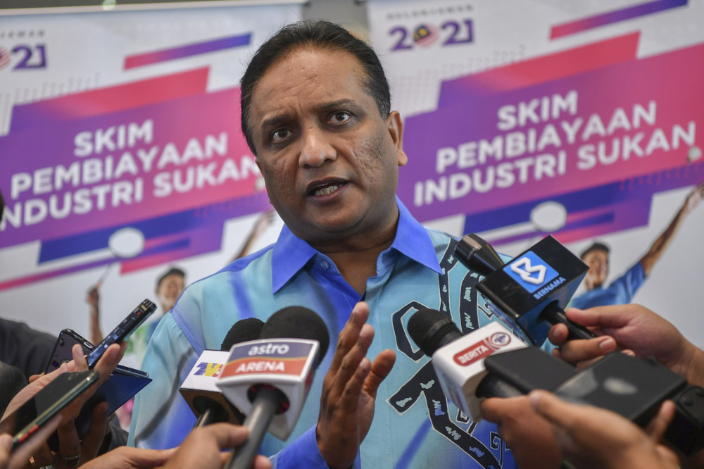 Youth and Sports Minister Datuk Seri Reezal Merican Naina Merican speaks to reporters after launching the Sports Industry Financing Scheme at the Ministry of Youth and Sports in Putrajaya, March 11, 2021. — Bernama pic