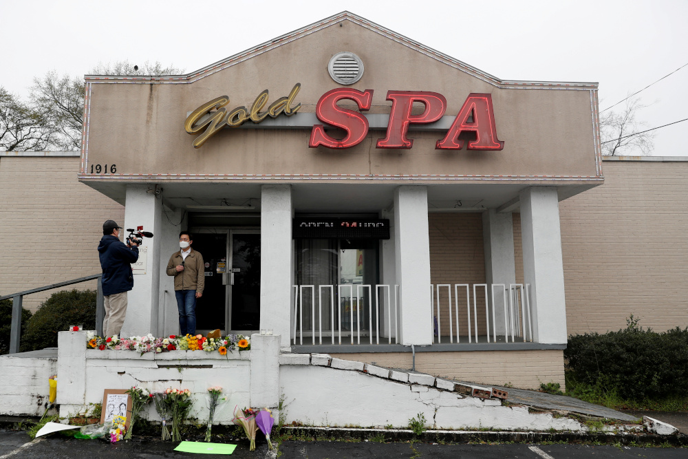 Flowers are laid in front of Gold Spa following the deadly shootings in Atlanta March 17, 2021. — Reuters pic