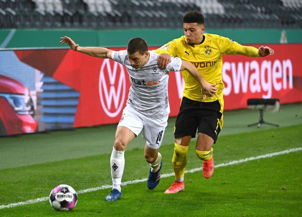 Borussia Moenchengladbach's Stefan Lainer in action with Borussia Dortmund's Jadon Sancho in the DFB Cup quarter final at Borussia-Park, Moenchengladbach March 2, 2021. — Reuters pic