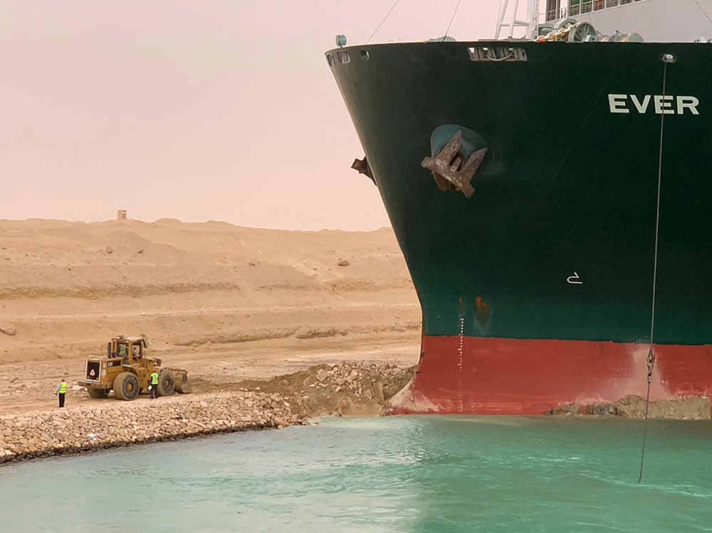 A handout picture released by the Suez Canal Authority March 24, 2021 shows a part of the Taiwan-owned MV Ever Given (Evergreen) lodged sideways and impeding all traffic across the waterway of Egypt's Suez Canal. — Suez Canal handout pic via AFP