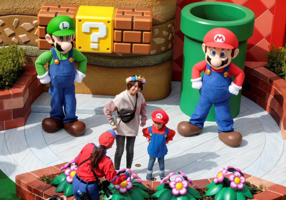Mario and Luigi characters greet visitors in front of Yoshi's Adventure attraction inside Super Nintendo World at the Universal Studios Japan theme park in Osaka March 17, 2021.— Reuters pic