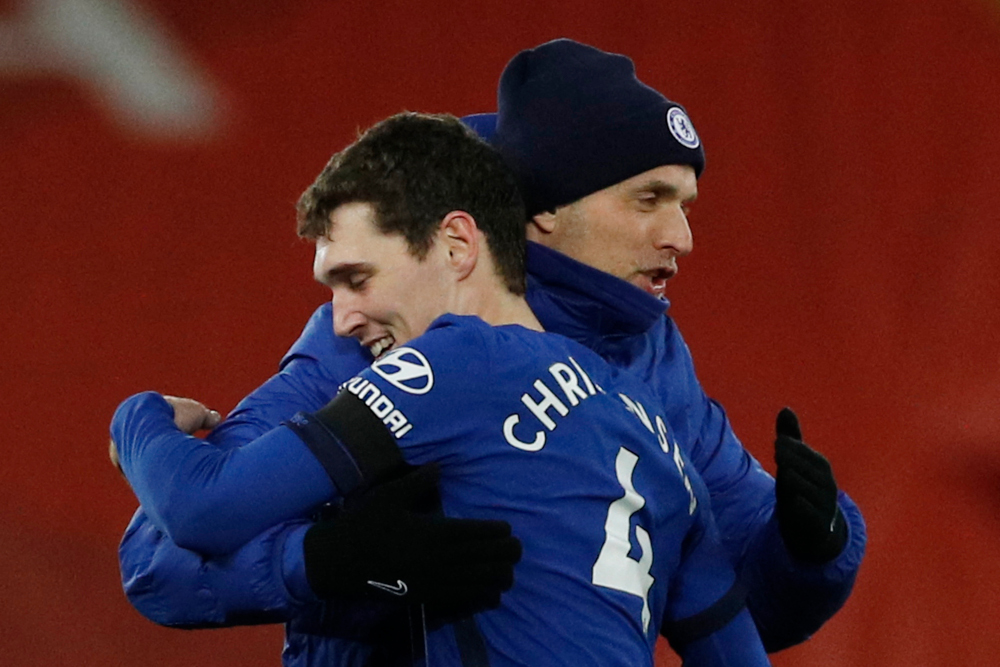 Chelsea head coach Thomas Tuchel embraces Chelsea defender Andreas Christensen at the end of the English Premier League football match between Liverpool and Chelsea at Anfield in Liverpool, north-west England March 4, 2021. — AFP pic