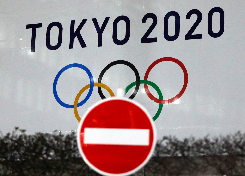 The logo of Tokyo 2020 Olympic Games that have been postponed to 2021 due to the coronavirus disease outbreak, is seen through a traffic sign at Tokyo Metropolitan Government Office building in Tokyo, Japan January 22, 2021. — Reuters pic