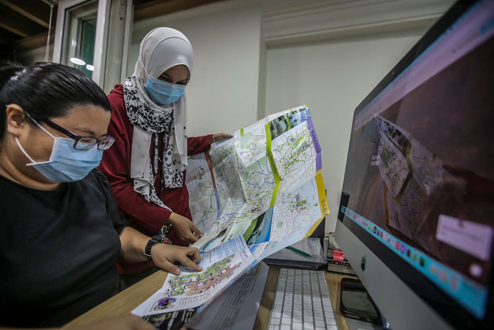 A general shot of travel agency employees managing customer bookings online during a survey at the Tourist Information and Interaction Centre in Kuala Lumpur, March 11, 2021. ― Picture by Hari Anggara