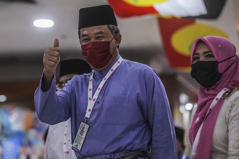 Umno deputy president Datuk Seri Mohamad Hasan arrives at the 2020 Umno annual general meeting in Kuala Lumpur March 27, 2021. ― Picture by Hari Anggara