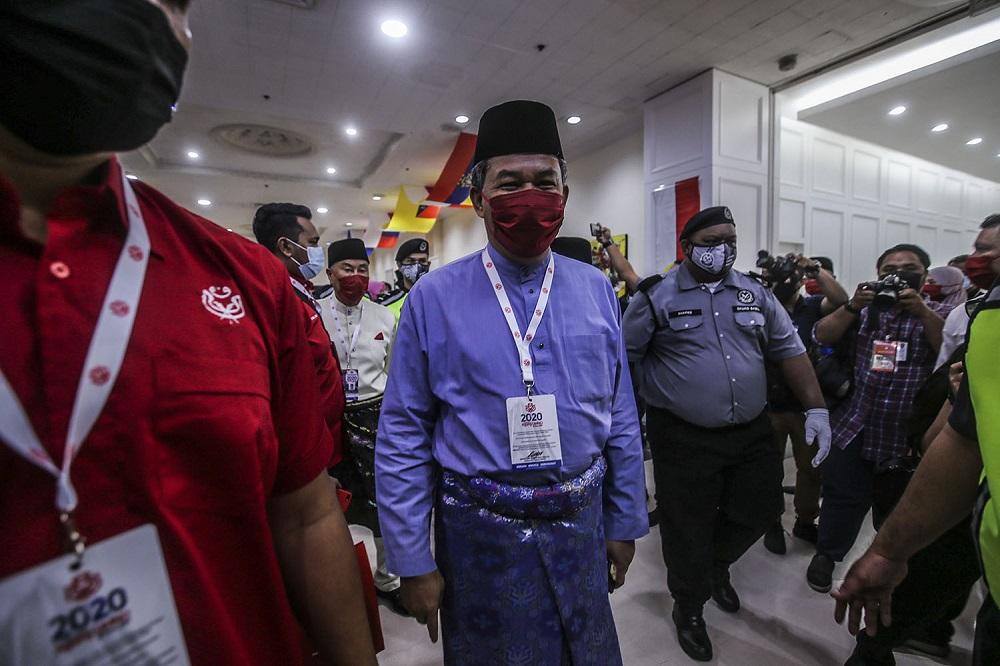 Datuk Seri Mohamad Hasan arrives at the 2020 Umno annual general meeting in Kuala Lumpur March 27, 2021. ― Picture by Hari Anggara