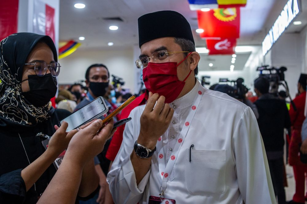 Umno Youth chief Datuk Asyraf Wajdi Dusuki speaks to reporters during the party's general assembly in Kuala Lumpur March 28, 2021. — Picture by Shafwan Zaidon