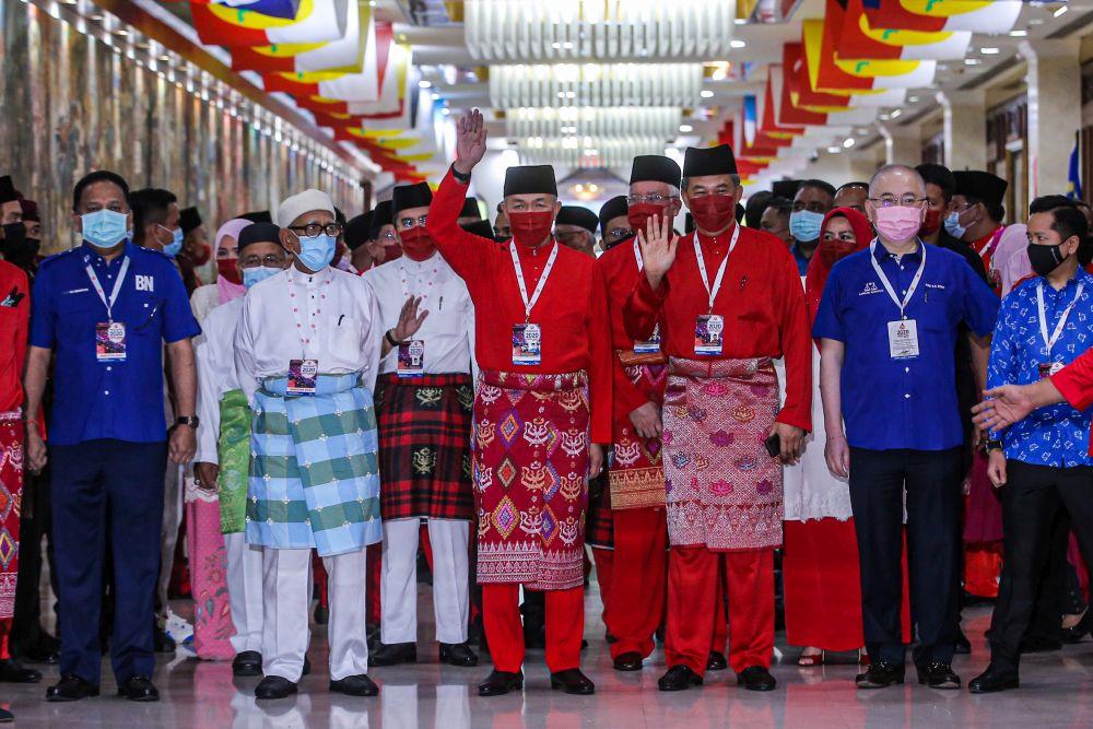 Umno president Datuk Seri Ahmad Zahid Hamidi waves at reporters at the World Trade Centre Kuala Lumpur March 28, 2021. — Picture by Hari Anggara