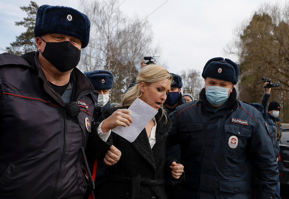 Russian police officers detain Anastasiya Vasilyeva, a doctor and ally of Kremlin critic Alexei Navalny, near the IK-2 corrective penal colony, where Navalny serves his jail term, in the town of Pokrov Russia April 6, 2021. — Reuters pic