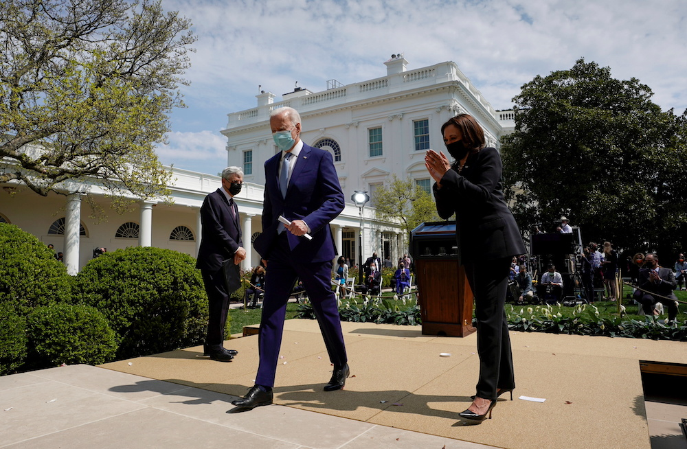 US Attorney General Merrick Garland watches as Vice President Kamala Harris applauds President Joe Biden after Biden announced administration efforts to curb gun violence in the Rose Garden at the White House in Washington April 8, 2021. — Reuters pic