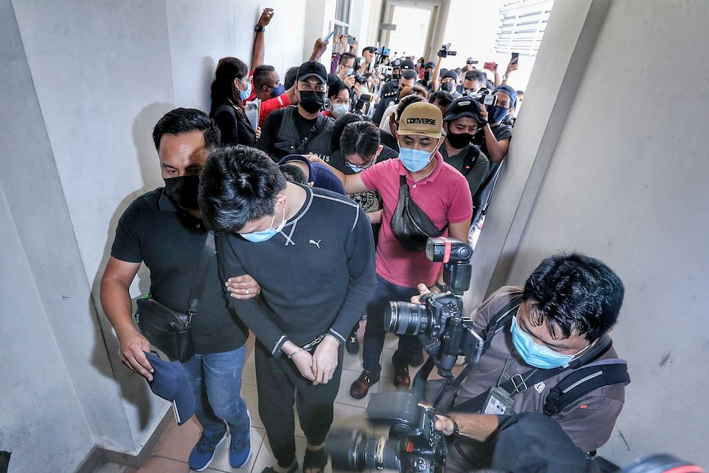 Fourteen members of the Nicky Gang at the Sessions Court in Petaling Jaya April 9, 2021. — Picture by Ahmad Zamzahuri