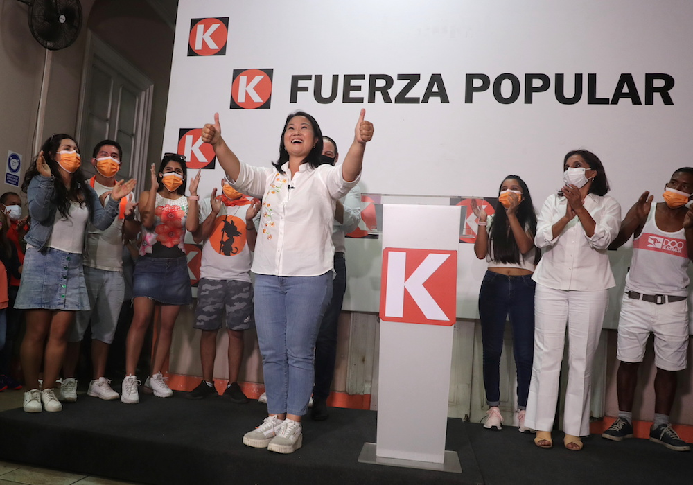 Peru's presidential candidate Keiko Fujimori of the Fuerza Popular party gives the thumbs up during a speech at party headquarters in Lima, Peru April 11, 2021. — Reuters pic