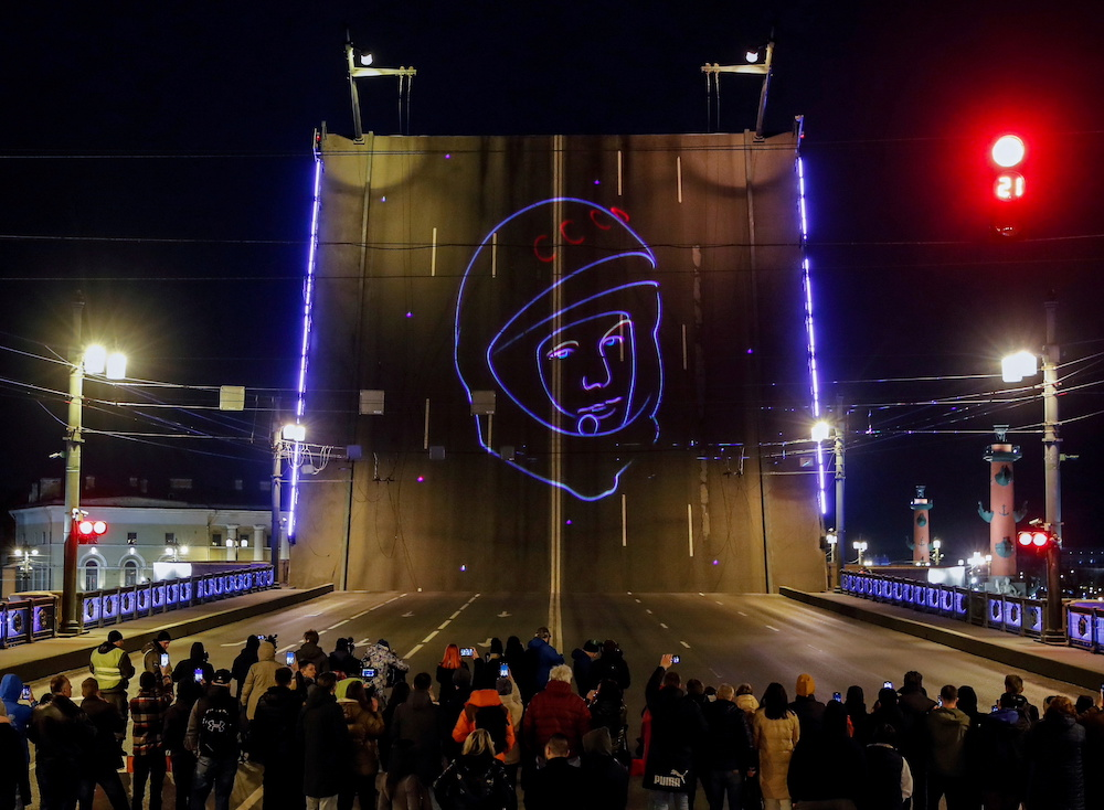 Spectators watch a projection of Yuri Gagarin's portrait to mark the 60th anniversary of the first human space flight in Saint Petersburg, Russia April 12, 2021. — Reuters pic