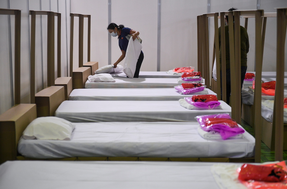 A healthcare worker prepares a bed inside a field hospital recently set up to fight the spread of Covid-19 as the country deals with a fresh wave of infections after tackling earlier outbreaks, in Bangkok, Thailand April 12, 2021. — Reuters pic