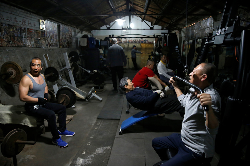 Men work out at a gym which has been turned from a bicycle shed inside a residential compound in the southwest of Beijing, China April 8, 2021. — Reuters pic