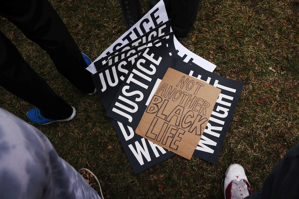 Signs are seen on the ground as protesters rally outside Brooklyn Center Police Department a day after Daunte Wright was shot and killed by a police officer, in Brooklyn Centre, Minnesota April 12, 2021. — Reuters pic