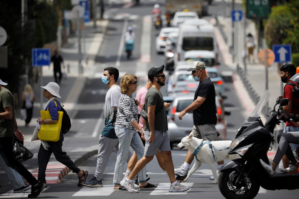 The Israeli health ministry reimposed a requirement for masks to be worn in enclosed public places. — Reuters pic