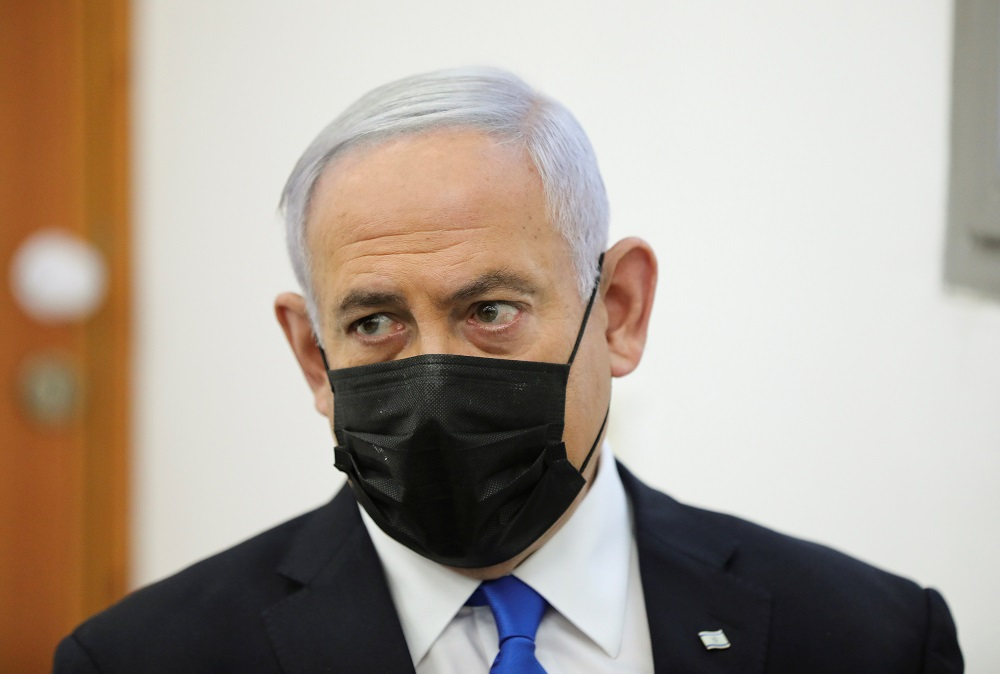 Israeli Prime Minister Benjamin Netanyahu, wearing a face mask, looks as his corruption trial resumes, at Jerusalem's District Court April 5, 2021. — Reuters pic