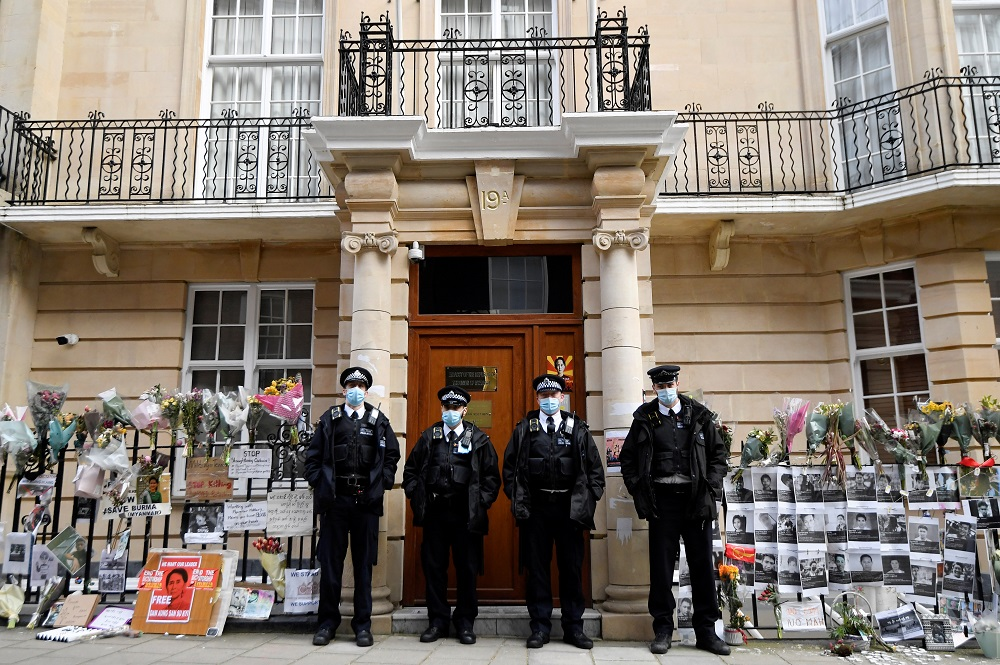 Police officers stand guard outside the Myanmar Embassy in London April 8, 2021. — Reuters pic