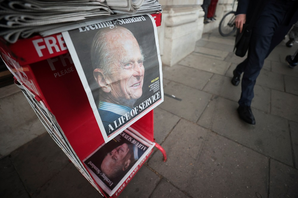 A picture of Britain's Prince Philip, husband of Queen Elizabeth, is seen on the front page of newspapers, after he died at the age of 99, in London April 9, 2021. — Reuters pic