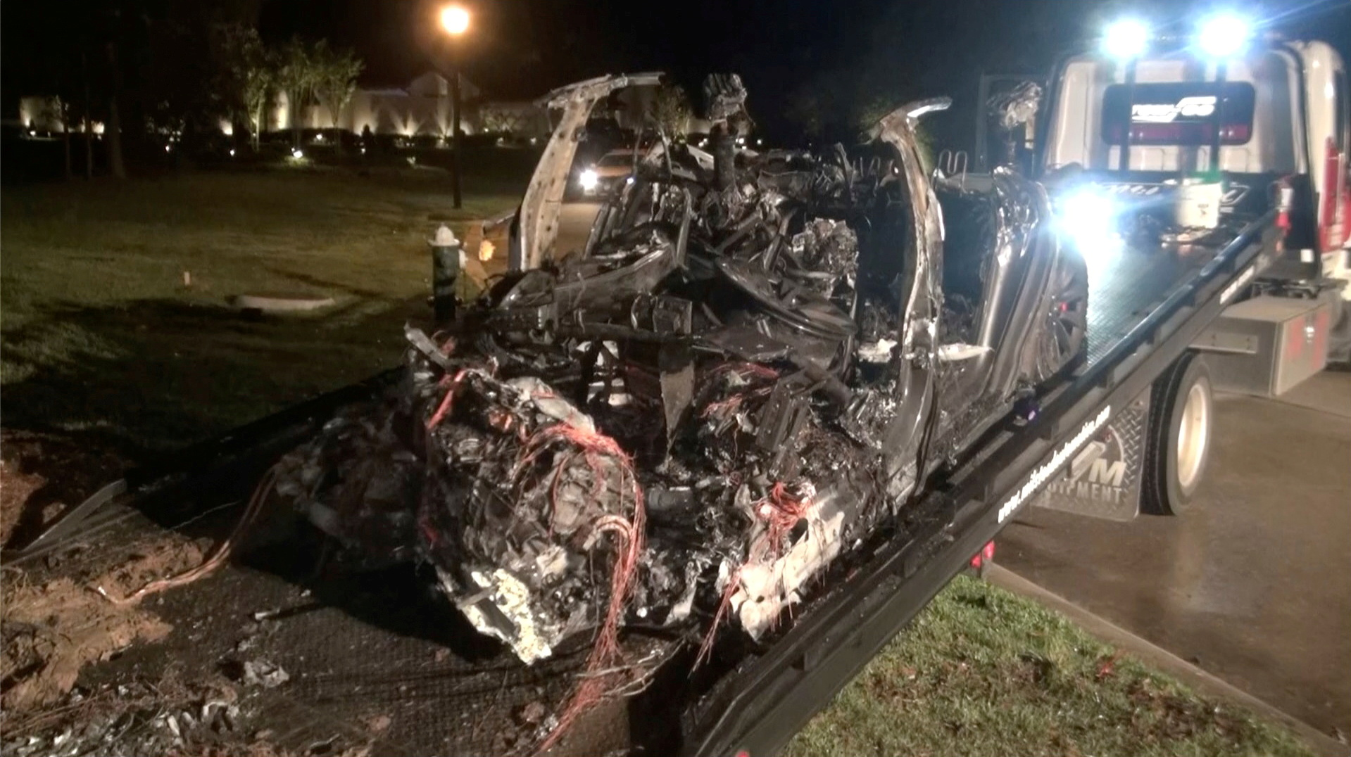 The remains of a Tesla vehicle are seen after it crashed in The Woodlands, Texas, April 17, 2021, in this still image from video obtained via social media. — Screen capture of video by Scott J. Engle via Reuters
