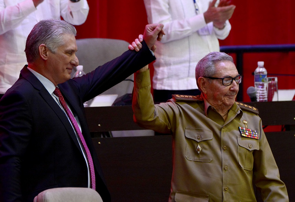 Cuba's President and newly-elected First Secretary of the Communist Party Miguel Diaz-Canel reacts as former Cuban President and First Secretary of the Communist Party Raul Castro raises his hand during the closing session of the VIII Congress of the Communist Party in Havana April 19, 2021. — Picture by Ariel Ley Royero/ACN via Reuters