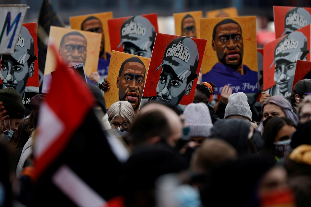 People hold placards with paintings of George Floyd, Daunte Wright and Philando Castile after the verdict in the trial of former Minneapolis police officer Derek Chauvin in Minneapolis April 20, 2021. — Reuters pic