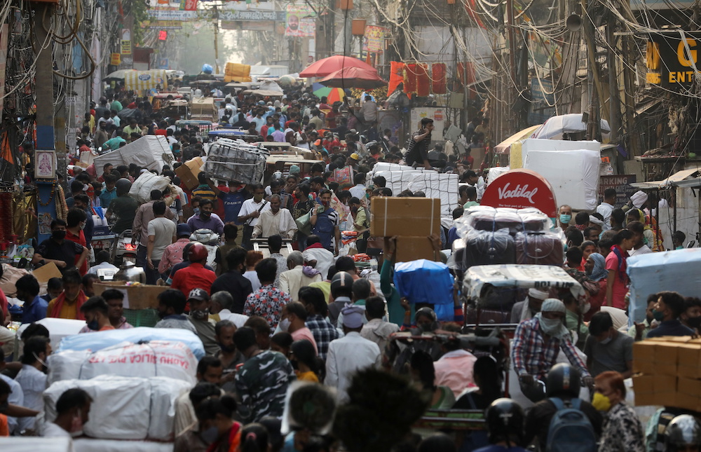 People walk at a crowded market amidst the spread of the coronavirus disease (Covid-19), in the old quarters of Delhi, India, April 6, 2021. — Reuters pic