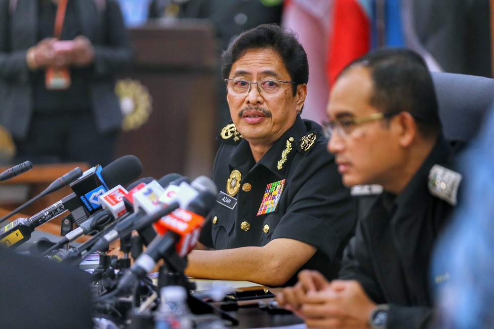 Malaysian Anti-Corruption Commission chief commissioner Datuk Seri Azam Baki (left) speaks during a press conference in Kuala Lumpur April 7, 2021. — Picture by Ahmad Zamzahuri